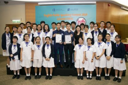 Merit Chan Ho Hin and Lau Pak Hei shared their joy with schoolmates and teacher after contest.